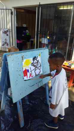 Easel Painting - Bramley Nursery School